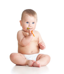 little baby brushing gums over white background