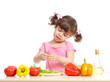 Little kid preparing vegetables for salad. Concept of healthy fo