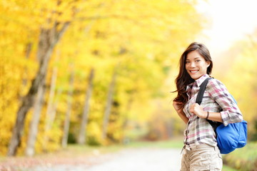 Fall hiking girl in autumn forest