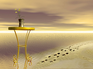 tavolino con vaso in spiaggia con impronte