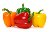 colored peppers over white background