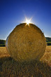 Straw bale against sunset