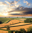 Landscape with straw bales against sunset - 44179104