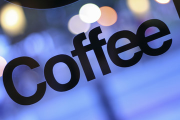 Coffee Sign in Window with Bokeh Background