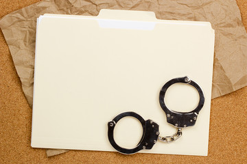 Handcuffs and Folder