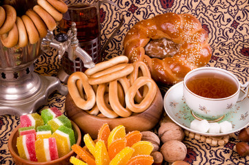 Samovar, a traditional old tea kettle with bagels and marmalades