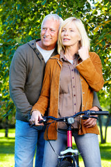 Happy senior couple cyclist.