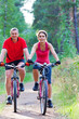 mature couple riding  bicycle