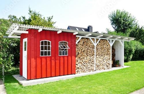Leinwandbild Motiv Holzlager Schweden