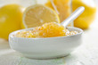 Homemade lemon jam in a china bowl with spoon and fresh fruits