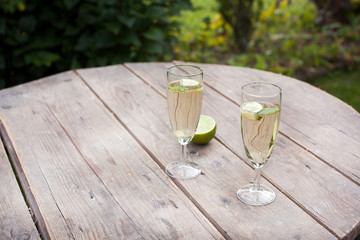 Champagne glasses with sirup and peppermint leaf