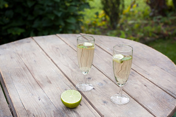 Champagne glasses with sirup and peppermint coctail hugo