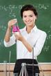 Smiley chemistry teacher hands an Erlenmeyer flask