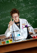 Showing forefinger mad professor is in his laboratory