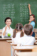 math teacher questions pupils at the chalkboard