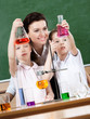 Little pupils study chemistry with their teacher