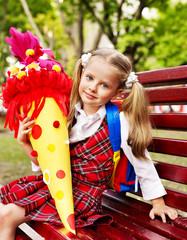 Happy child with school cone.