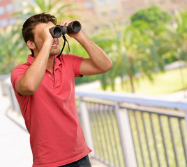 casual man looking into binocular