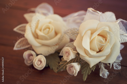 Two wedding boutonnieres of roses