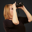 Women looking through binoculars