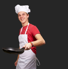Portrait Of A Chef Holding Pan