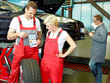 Master mechanic explaining  tyre labeling to a trainee in a gara
