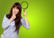 Portrait Of A Girl Holding A Magnifying Glass And Thinking