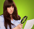 Portrait Of A Girl Holding A Magnifying Glass And Paper
