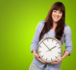 A Young Girl Holding A Clock