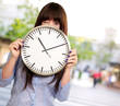 Woman Holding Clock Winking