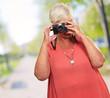 Senior Woman Clicking Photo
