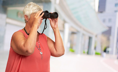 A Senior Woman Looking Through Binoculars