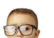 portrait of kid wearing glasses against a white background