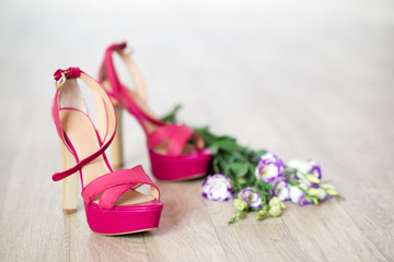 Fashion high heel shoes and flowers close-up