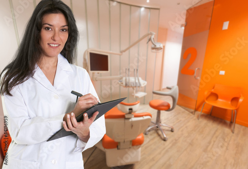 Friendly dentist filling a file