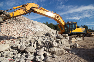 Construction demolition waste and excavator