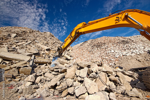 Demolition waste recycling site and excavator boom
