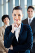 beautiful young businesswoman and team portrait