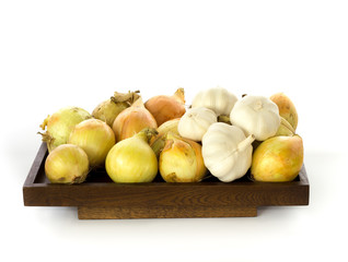 Onions and garlic presented on a wooden board