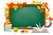 Green desk with school supplies and autumn leaves
