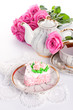 Сake with roses and cup of tea
