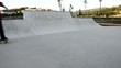 Skateboarder grinding a curb