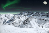 Aurora and moon in mountains - 44204321
