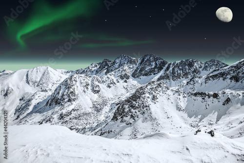 Fototapeta Aurora and moon in mountains