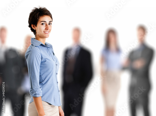 Businesswoman in front of a business team