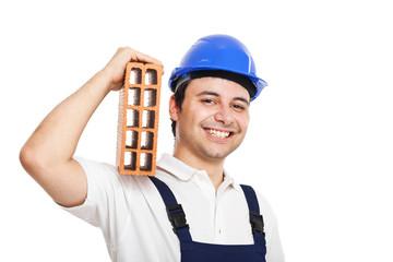 Construction man holding a brick