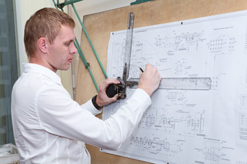 Engineer making blueprint project on old-fashioned drawing board