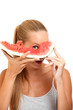 funny woman posing with melon