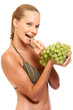 young woman enjoys eating some grapes