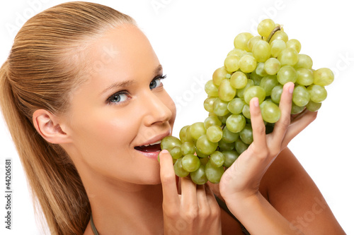 closeup portrait of a healthy woman bites in grape